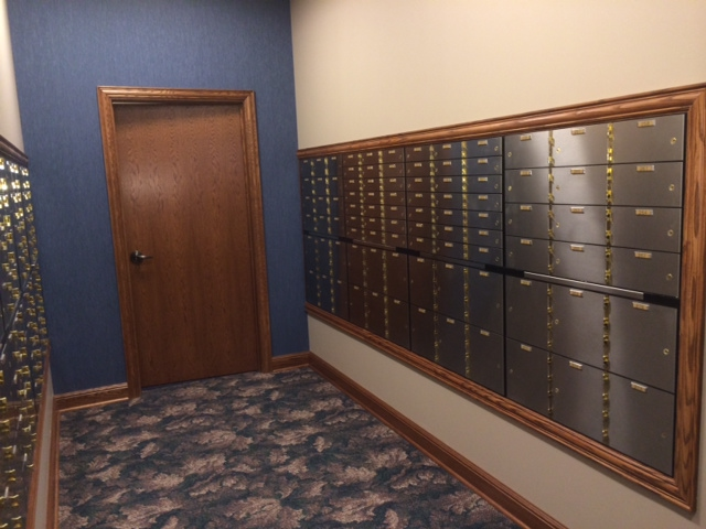 Image of safety deposit boxes in a bank.